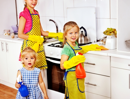 aprons: Children little girl cooking at kitchen. Stock Photo