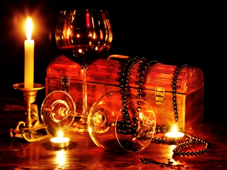 Two wine glass and candle on dark photo