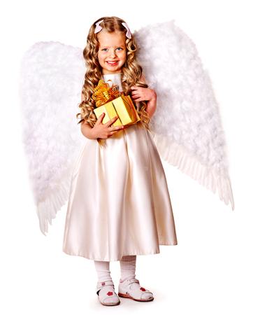 birthday angel: Child at angel costume holding gift box.  Full length.