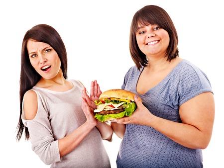 Women eating hamburger. Isolated. Stock Photo - 22673137