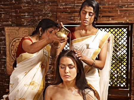 east indians: Young woman having head ayurveda spa treatment.