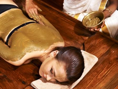 panchakarma: Young woman having body Ayurveda spa massage.