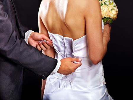 Beautiful bridal trying on wedding dress. photo