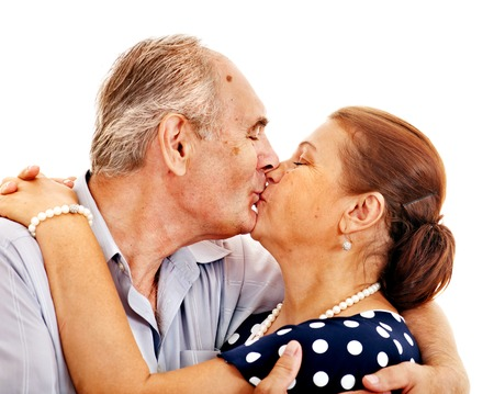 Old man embracing woman . Isolated. photo