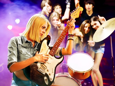 Musical group playing in night club. Male and female. Stock Photo - 22847085