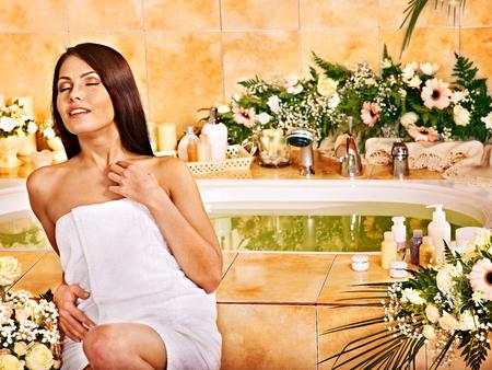 Woman applying moisturizer at bathroom. Stock Photo - 22847091
