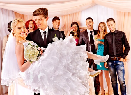 Groom  carries bride on his hands  at wedding. Stock Photo - 22847103