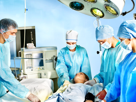 Group of surgeon and patient in operating room. Stock Photo - 23013010