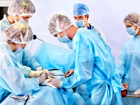 Team surgeon at work in operating room. Stock Photo - 23012914