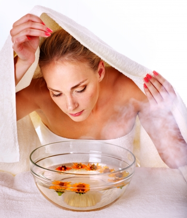 Facial massage with steam treatment. photo