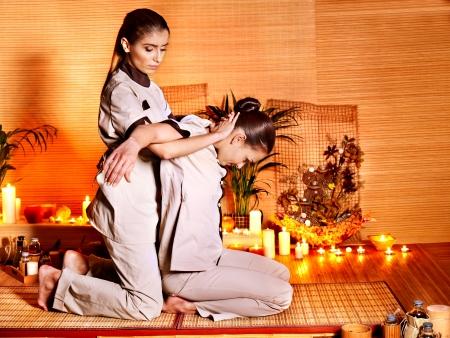 thai massage: Therapist giving Thai stretching massage to woman. Stock Photo
