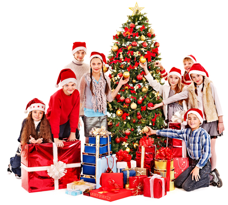 Group people and  Santa holding gift box near  Christmas tree. photo