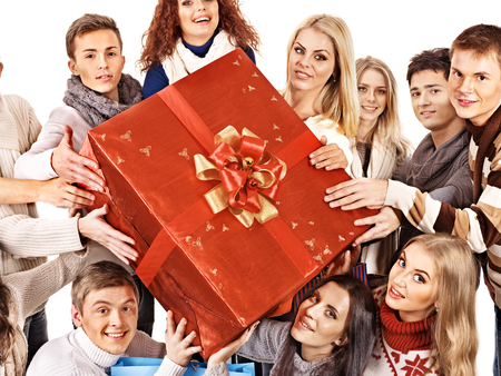 Group people holding red big gift box. Isolated. photo