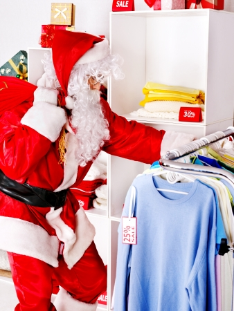 clothing store: Santa Claus in clothing store. Christmas sale.