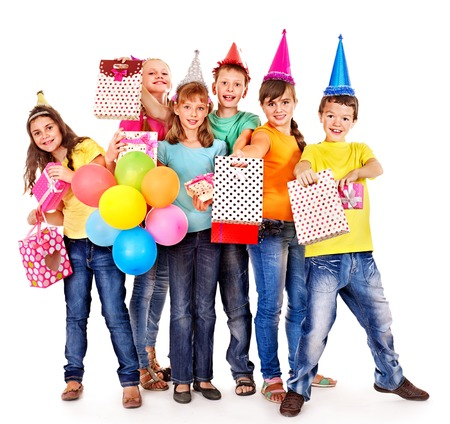 Birthday party group of teen people with clown. Isolated. Stock Photo - 23353892