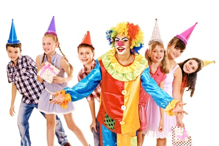 Birthday party group of teen people with clown. Isolated. Stock Photo - 23353901