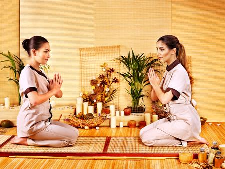 Women at luxury bamboo spa . photo