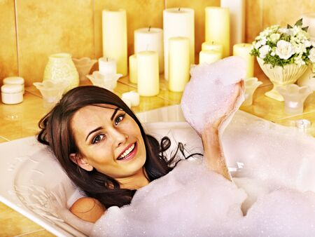 bathing women: Woman relaxing at water in bubble bath.