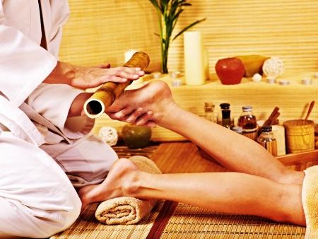 Woman getting feet massage Male therapist. photo