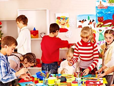 Child painting at art school. Education. photo