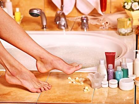 bubble bath: Female  feet in bubble bath. Skincare.