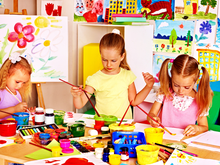 Happy children  painting at school. photo