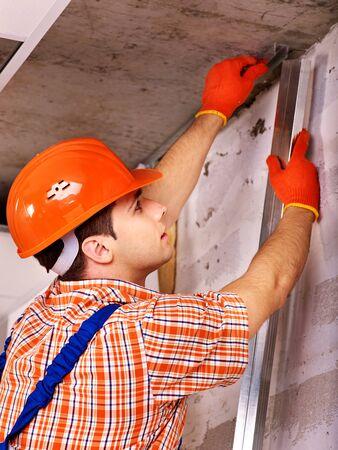 Happy man in builder uniform indoor. photo