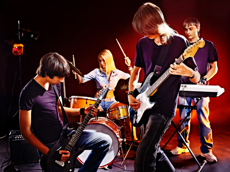 Group peole playing  guitar in night club. Stock Photo - 23702084