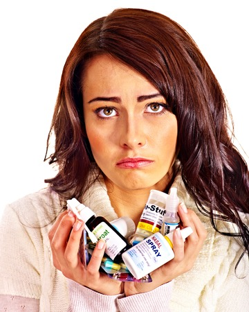 cold remedy: Young woman having pills and tablets  Isolated