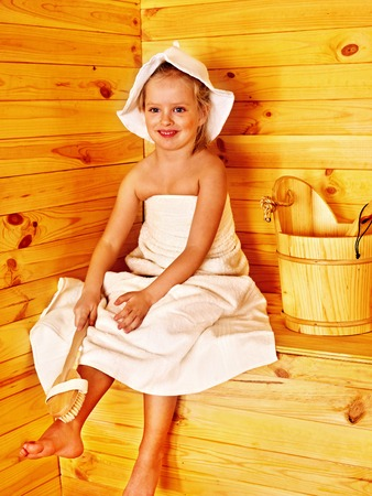 Happy with child relaxing at sauna. photo