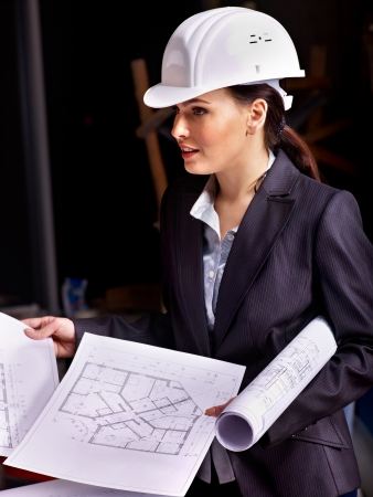 Business woman in builder helmet indoor. photo
