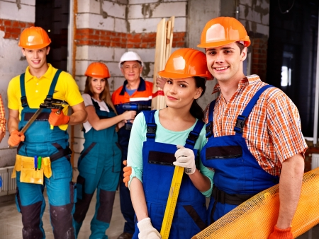 Happy group people in builder uniform. photo