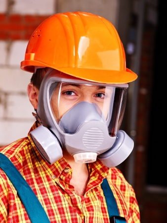 respirator: Man in builder  respirator indoor.