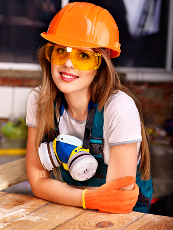 respirator: Woman in builder  respirator indoor. Stock Photo