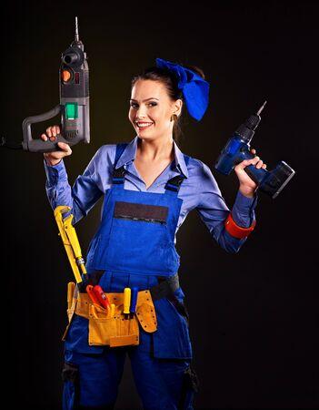 outils construction: Femme heureuse avec un constructeur d'outils de construction. Banque d'images
