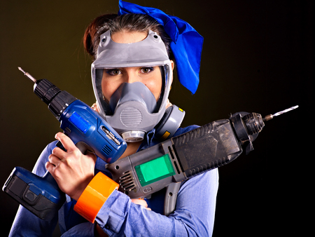 Happy woman builder with construction tools. Stock Photo - 23856375