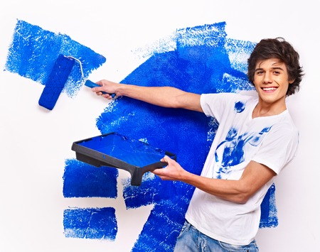 Happy man paint wall at home. Stock Photo - 23856435