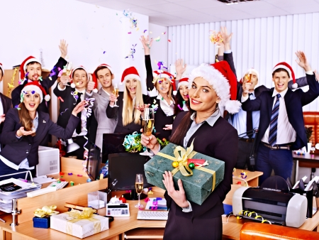 Happy business group people in santa hat at Xmas party.