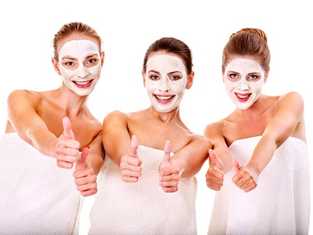 spa face: Young woman getting facial mask and gossip . Isolated.