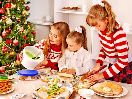Children rolling dough in Xmas kitchen. photo