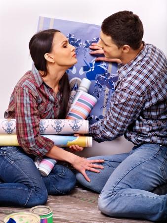 Happy family glues wallpaper at home. Stock Photo - 24041150