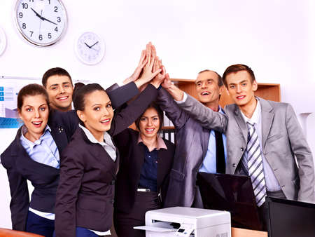 Happy group business people with hand together in office. photo