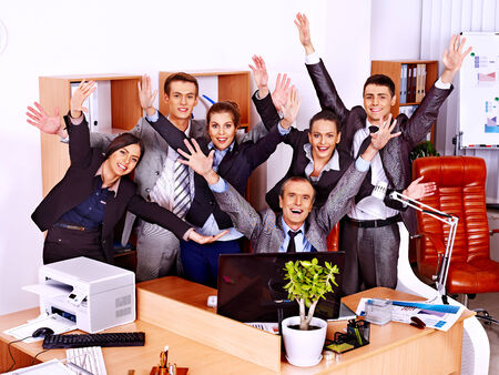 Happy group business people with hand up in office. photo