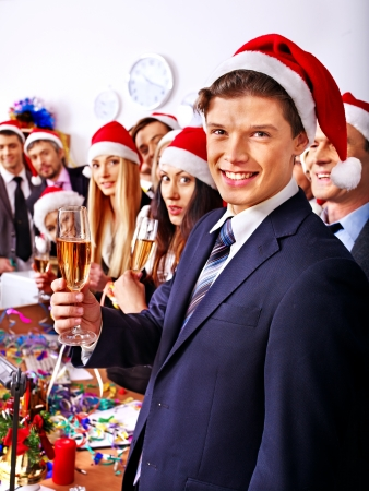 Happy business group people in santa hat at Xmas party. Stock Photo - 24041189