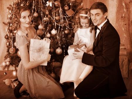 Family with children  dressing Christmas tree. Black and white retro. Stock Photo - 24177247