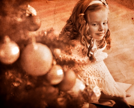 Child  receiving gifts under Christmas tree. Black and white retro. photo