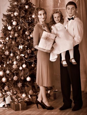 Family with children  dressing Christmas tree. Black and white retro. Stock Photo - 24177252