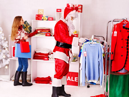 Santa Claus in clothing store. Christmas sale. photo