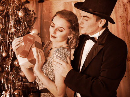 Couple on party near Christmas tree. Black and white retro. Stock Photo - 24177193