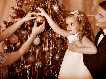 Family with children  dressing Christmas tree. Black and white retro. Stock Photo - 24177014